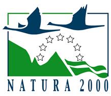 Logotipo de Natura 2000. Dos patos sobrevolando unas montañas.